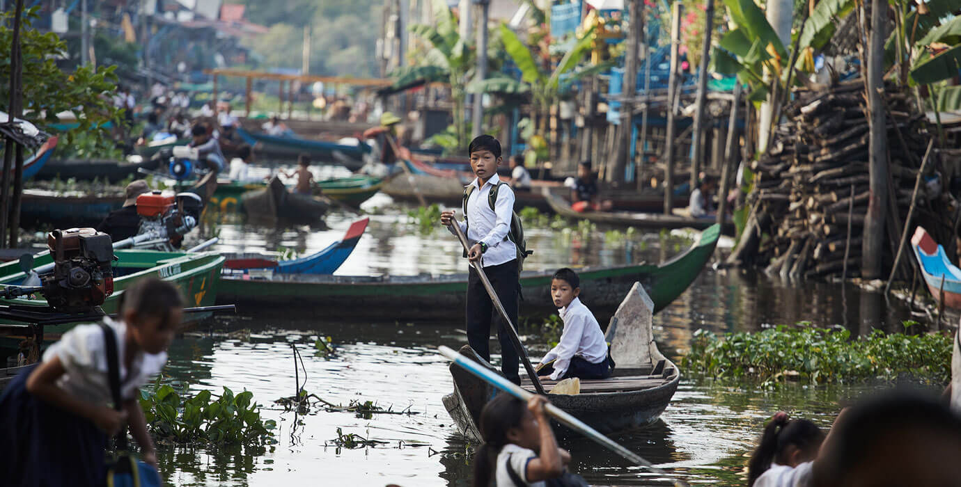Cambodia---Kids-rowing-to-School